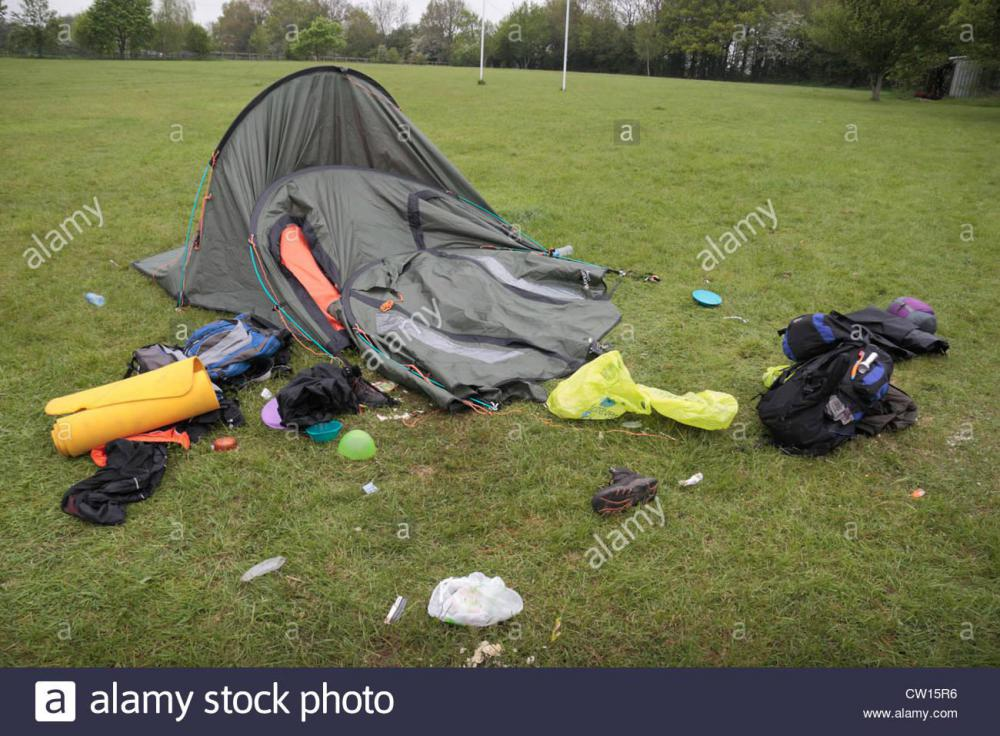 an-incredibly-messy-three-man-collapsed-tent-on-a-uk-camp-site-this-CW15R6.jpg
