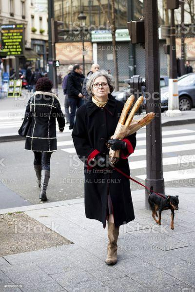 woman-walking-with-her-dog-and-baguette-bread-in-paris-picture-id458983879.cf.jpg